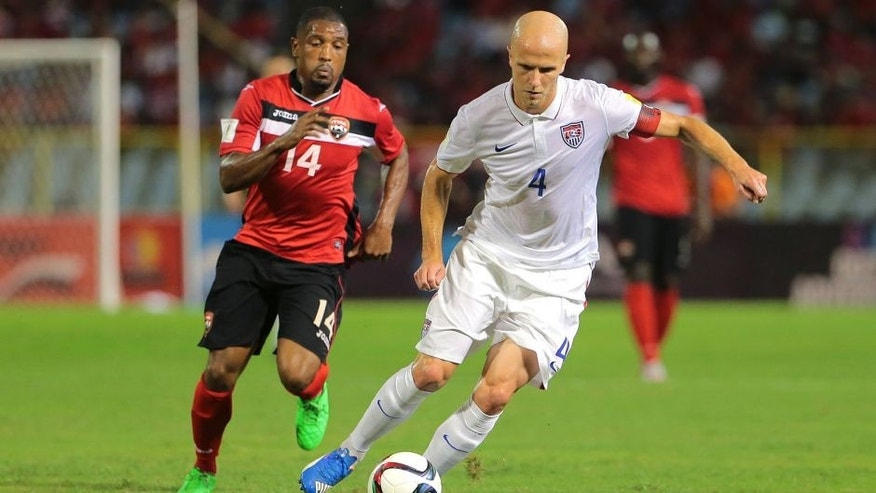 PORT OF SPAIN, TRINIDAD & TOBAGO - NOVEMBER 17: Usa's captain Michael Bradley #4 makes an attacking run as T&T's Andre Boucaud #14 chases during a World Cup Qualifier between Trinidad and Tobago and USA as part of the FIFA World Cup Qualifiers for Russia 2018 at Hasely Crawford Stadium on November 17, 2015 in Port of Spain, Trinidad & Tobago. (Photo by Ashley Allen Getty Images)