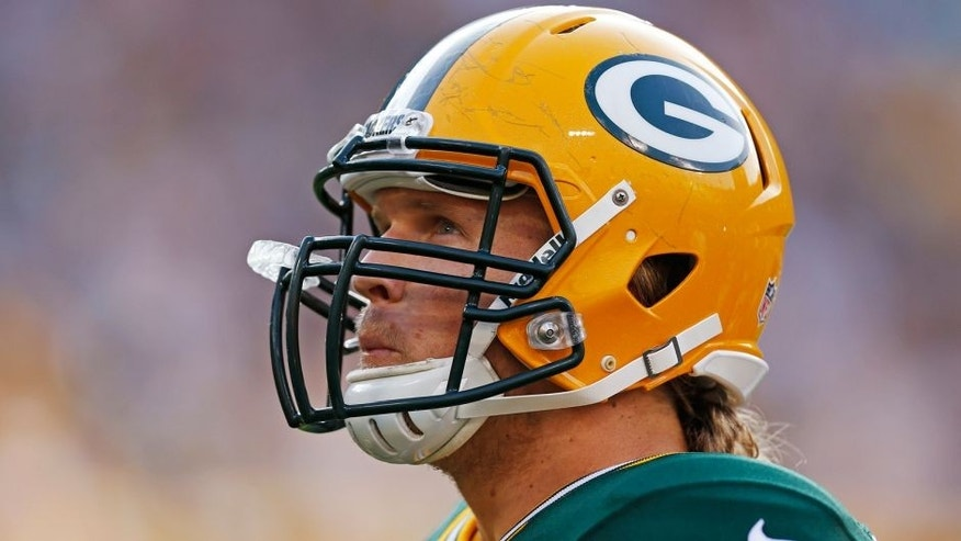 <p>Green Bay Packers outside linebacker Clay Matthews looks up during the Family Night practice of NFL football training camp Saturday Aug. 2, 2014, in Green Bay, Wis. (AP Photo/Matt Ludtke)</p>
