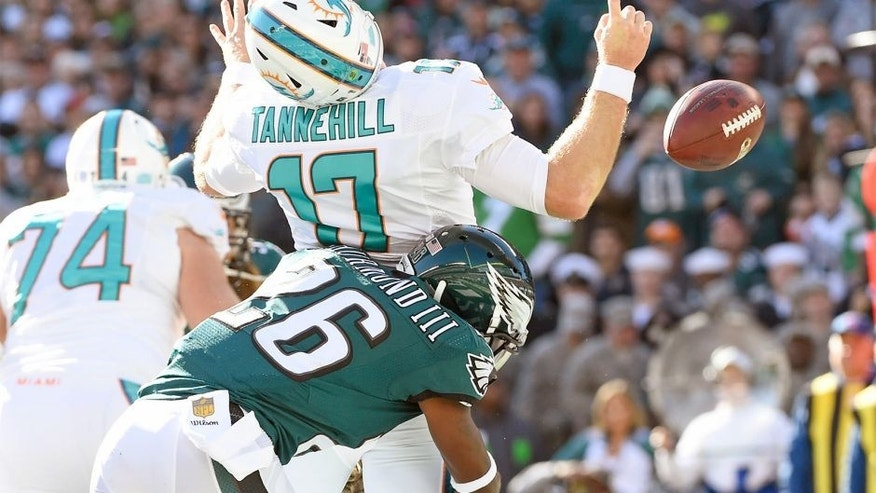 Nov 15, 2015; Philadelphia, PA, USA; Philadelphia Eagles strong safety Walter Thurmond (26) sacks Miami Dolphins quarterback Ryan Tannehill (17) causing a fumble in the end zone for a safety during the first quarter at Lincoln Financial Field. Mandatory Credit: Eric Hartline-USA TODAY Sports