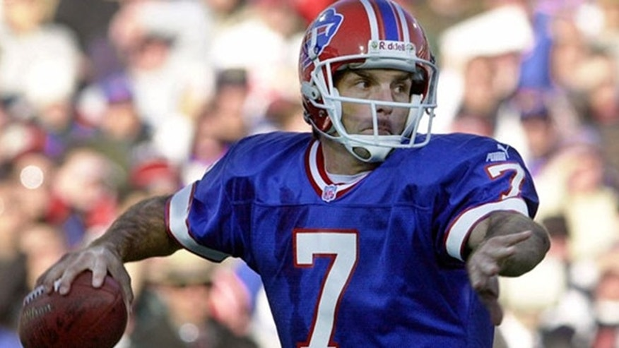 Buffalo Bills quarterback Doug Flutie looks to throw game against the New York Jets in Orchard Park, N.Y., in this Oct. 29, 2000 photo. (AP Photo/Mike Groll)