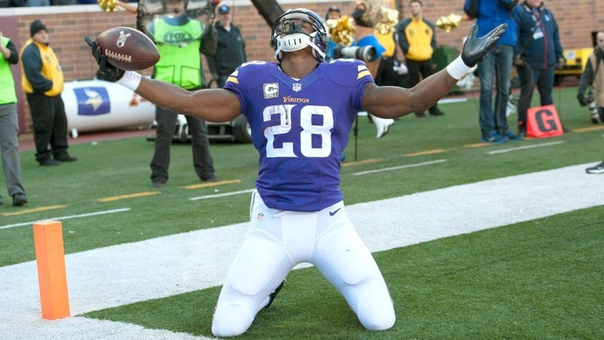 Adrian Peterson #28 of the Minnesota Vikings celebrates a touchdown during an NFL game against the St. Louis Rams at TCF Bank Stadium November 8, 2015 in Minneapolis, Minnesota. (Photo by Tom Dahlin/Getty Images)