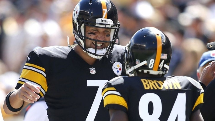 Sep 7, 2014; Pittsburgh, PA, USA; Pittsburgh Steelers quarterback Ben Roethlisberger (7) and wide receiver Antonio Brown (84) celebrate a touchdown against the Cleveland Browns during the second quarter at Heinz Field. Mandatory Credit: Charles LeClaire-USA TODAY Sports