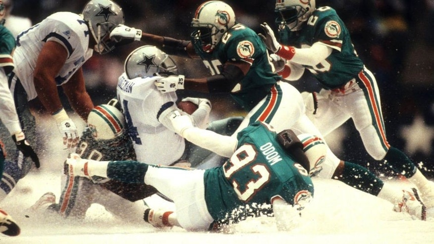IRVING, TX - NOVEMBER 25: Running back Lincoln Coleman #44 of the Dallas Cowboys is wrapped up by the Miami Dolphins defense at Texas Stadium on November 25, 1993 in Irving, Texas. The Dolphins defeated the Cowboys 16-14. (Photo by Joseph Patronite/Getty Images)