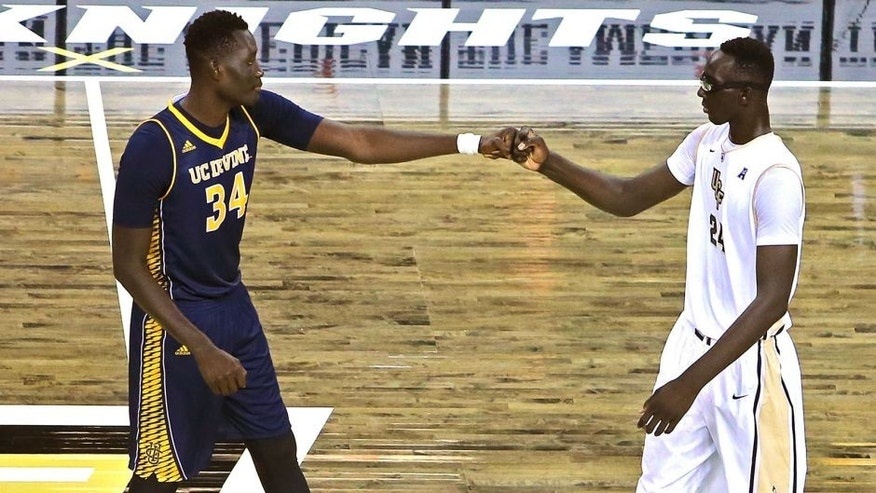 ORLANDO, FL - NOVEMBER 18: Mamadou Ndiaye #34 of the UC Irvine Anteaters (L) and Tacko Fall #24 of the UCF Knights bump fists with each other at half court prior to tipoff of an NCAA basketball game between the California-Irvine Anteaters and the UCF Knights at the CFE Arena on November 18, 2015 in Orlando, Florida. California-Irvine won the game 61-60 in overtime. (Photo by Alex Menendez/Getty Images)