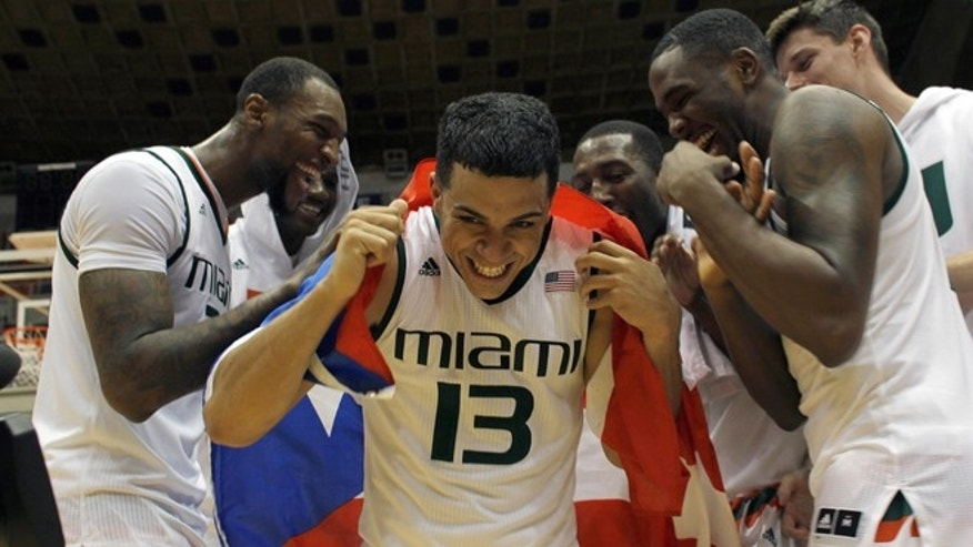 Angel Rodriguez is congratulated by his teammates in San Juan, Sunday, Nov. 22, 2015.