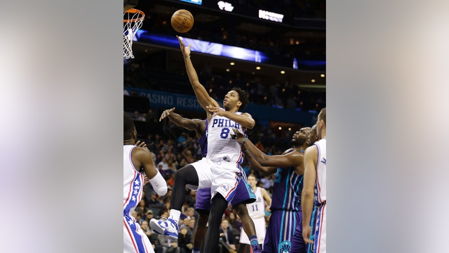 FILE - In this photo taken on Nov. 20, 2015, Philadelphia 76ers' Jahlil Okafor (8) slips through the lane and past a host of Charlotte Hornets as he scores in the second half of an NBA basketball game in Charlotte, N.C.