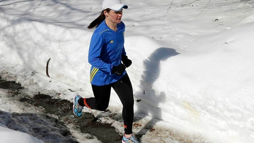 Feb. 27, 2015: Becca Pizzi trains for the Boston Marathon along Heartbreak Hill in Newton, Mass. Pizzi, a veteran of 45 marathons, vies to be the first American woman to complete the World Marathon Challenge -- seven marathons in seven days on seven continents -- in January 2016. (AP)