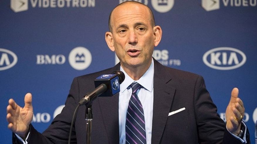FILE - In this June 11, 2014, file photo, MLS Commissioner Don Garber speaks to reporters prior to an MLS soccer game between the Montreal Impact and DC United in Montreal. Garber says he doesnât see the MLS Cup final between two small market teams _ Portland and Columbus _ as less-than ideal.  (AP Photo/The Canadian Press, Graham Hughes)