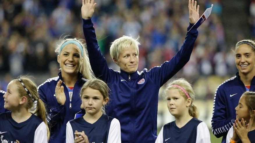 FILE - In this Oct. 21, 2015, file photo, United States' Megan Rapinoe waves to fans before a friendly soccer match against Brazil, in Seattle. American World Cup champion Megan Rapinoe has torn a ligament in her right knee that will require surgery, putting her Olympic chances in doubt. The U.S. Soccer Federation announced Saturday, Dec. 5, 2015,  that the Seattle Reign midfielder tore the anterior cruciate ligament in her right knee during Friday training in Honolulu. (AP Photo/Elaine Thompson, FILe)