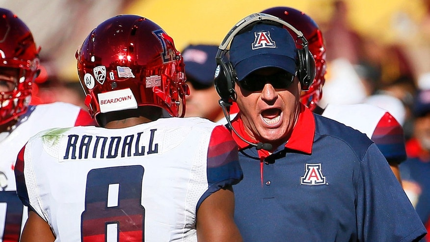 Arizona head coach Rich Rodriguez yells at quarterback Jerrard Randall (8) during the first half of an NCAA college football game against Arizona State, Saturday, Nov. 21, 2015, in Tempe, Ariz. (AP Photo/Matt York)