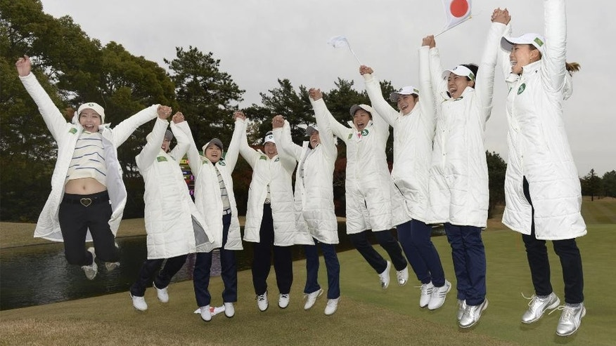 Japan LPGA team members led by its captain Momoko Ueda, right, jump hands in hands in celebration after capturing the inaugural Queens match-play tournament between teams from different women's golf tours, in Nagoya, central Japan, Sunday, Dec. 6, 2015. The Japan took six of 18 singles matches and finished 41 points, ahead of Korea on 38, the Ladies European Tour team on 12 and the Australia Ladies Professional Golf team with seven. (Mizuki Ikari/Kyodo News via AP) JAPAN OUT, CREDIT MANDATORY