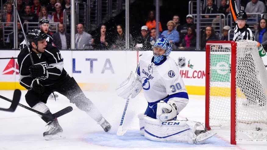 Los Angeles Kings left wing Milan Lucic, left, scores on Tampa Bay Lightning goalie Ben Bishop during the second period of an NHL hockey game, Sunday, Dec. 6, 2015, in Los Angeles. (AP Photo/Mark J. Terrill)