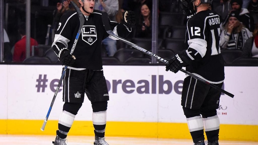 Los Angeles Kings defenseman Brayden McNabb, left, celebrates his goal with Los Angeles Kings right wing Marian Gaborik, of Slovakia, during the second period of an NHL hockey game against the Tampa Bay Lightning, Sunday, Dec. 6, 2015, in Los Angeles. (AP Photo/Mark J. Terrill)