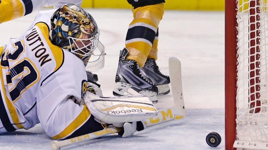 Nashville Predators goalie Carter Hutton (30) looks back at the puck after giving up a goal to Boston Bruins left wing Loui Eriksson during the second period of an NHL hockey game in Boston, Monday, Dec. 7, 2015. (AP Photo/Charles Krupa)