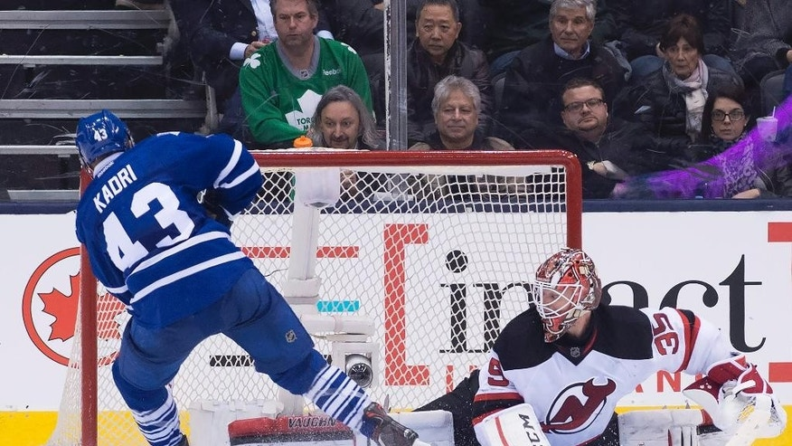 Toronto Maple Leafs' center Nazem Kadri (43) scores the game winning goal in a shootout past New Jersey Devils' goalie Cory Schneider (35) during NHL hockey action, in Toronto on Tuesday, Dec. 8, 2015. (Nathan Denette/The Canadian Press via AP)