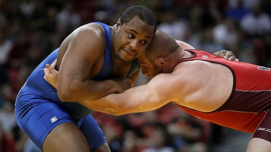 LAS VEGAS - JUNE 15: Daniel Cormier (blue) wrestles Damion Hahn (red) in the Freestyle 96kg division championship match during the USA Olympic trials for wrestling and judo on June 15, 2008 at the Thomas & Mack Center in Las Vegas, Neveda. (Photo by Jonathan Ferrey/Getty Images)