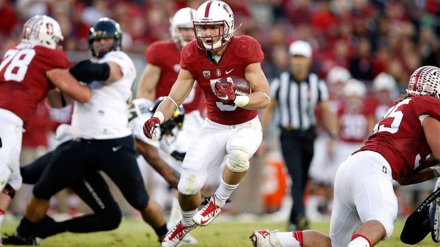 PALO ALTO, CA - NOVEMBER 14: Christian McCaffrey #5 of the Stanford Cardinal runs with the ball against the Oregon Ducks at Stanford Stadium on November 14, 2015 in Palo Alto, California. (Photo by Ezra Shaw/Getty Images)