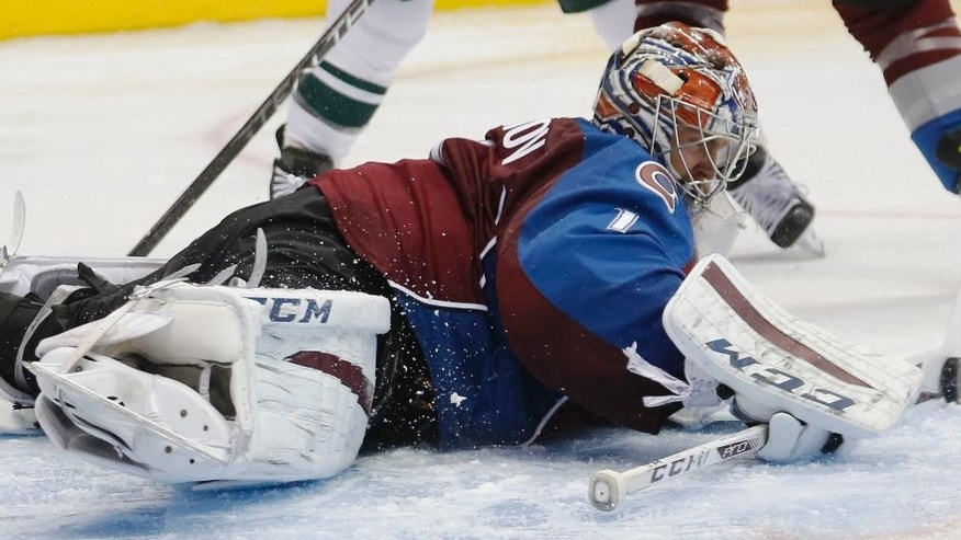Colorado Avalanche goalie Semyon Varlamov, of Russia, makes a stick save during the second period of an NHL hockey game against the Minnesota Wild, Monday, Dec. 7, 2015, in Denver. (AP Photo/David Zalubowski)