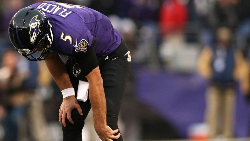 BALTIMORE, MD - NOVEMBER 22: Quarterback Joe Flacco #5 of the Baltimore Ravens winces in pain on the final drive of the fourth quarter against the St. Louis Rams at M&T Bank Stadium on November 22, 2015 in Baltimore, Maryland. The Baltimore Ravens won, 16-13. (Photo by Patrick Smith/Getty Images)