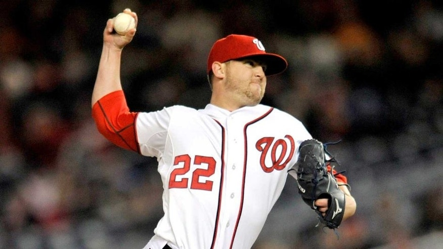 Apr 18, 2014; Washington, DC, USA; Washington Nationals pitcher Drew Storen (22) throws in the eighth inning against the St. Louis Cardinals at Nationals Park. The Nationals defeated the Cardinals 3-1. Mandatory Credit: Joy R. Absalon-USA TODAY Sports