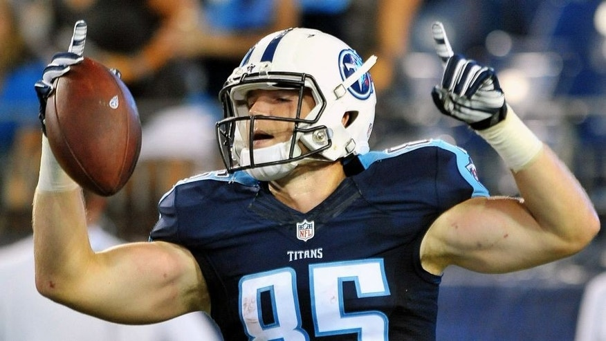 Aug 23, 2015; Nashville, TN, USA; Tennessee Titans tight end Chase Coffman (85) celebrates scoring a touchdown after catching a pass from Titans quarterback Alex Tanney (not pictured) during the second half at Nissan Stadium. Titans won 27-14. Mandatory Credit: Jim Brown-USA TODAY Sports
