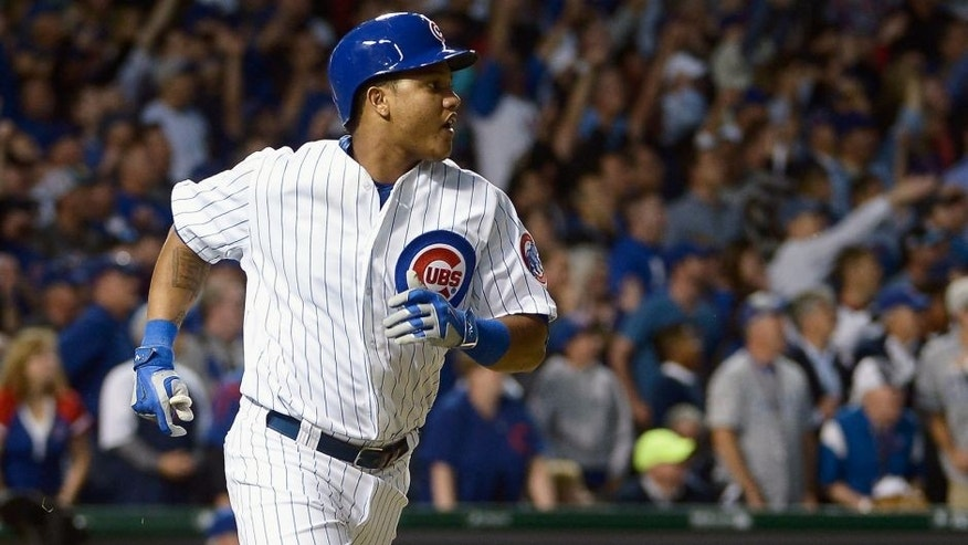 CHICAGO, IL - OCTOBER 12: Starlin Castro #13 of the Chicago Cubs runs the bases after hitting a solo home run in the fourth inning against the St. Louis Cardinals during game three of the National League Division Series at Wrigley Field on October 12, 2015 in Chicago, Illinois. (Photo by David Banks/Getty Images)