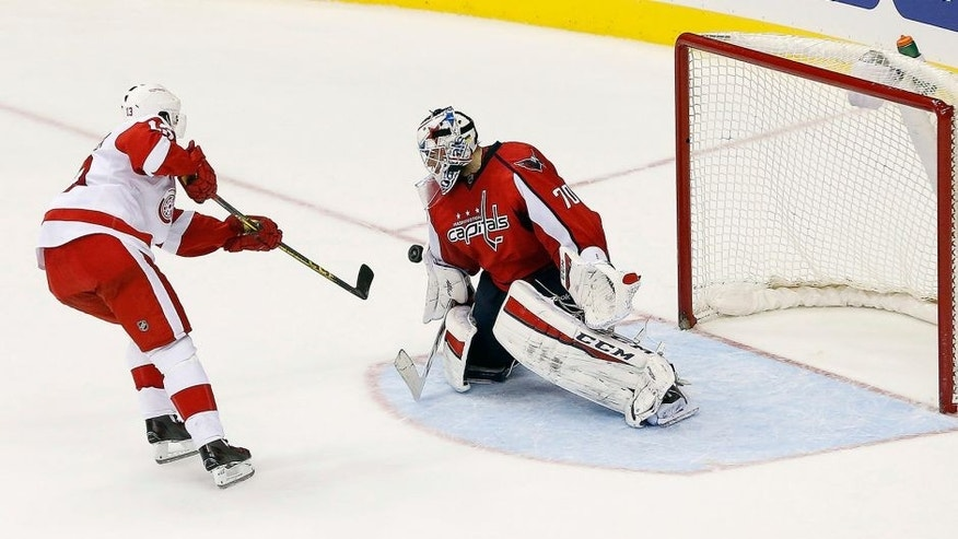 Dec 8, 2015; Washington, DC, USA; Washington Capitals goalie Braden Holtby (70) makes the game clinching save against Detroit Red Wings center Pavel Datsyuk (13) in a shootout at Verizon Center. The Capitals won 3-2 in a shootout. Mandatory Credit: Geoff Burke-USA TODAY Sports