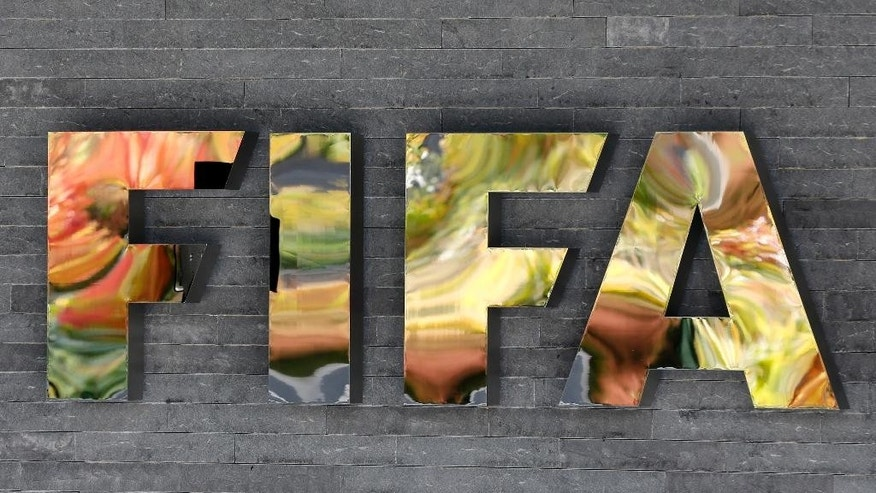 FILE - In this Sept. 25, 2015 file photo, the FIFA logo is fixed on a wall of the FIFA headquarters in Zurich, Switzerland. So far, 16 of FIFA's 209 member associations have been implicated in an ongoing U.S. Department of Justice investigation of decades of soccer bribery and graft, by virtue of the fact that either their presidents or ex-presidents _ or both in the cases of Brazil, Honduras and Guatemala _ are among those indicted or who have pleaded guilty.  (AP Photo/Michael Probst, File)