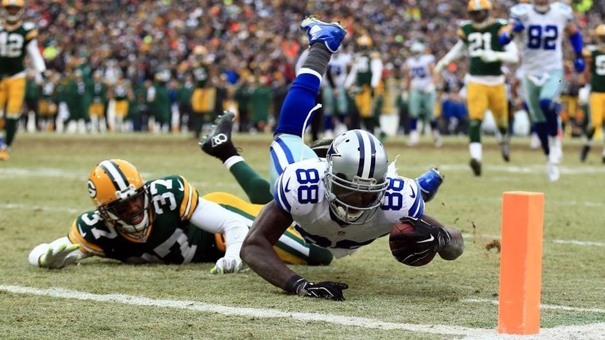 Jan 11, 2015; Green Bay, WI, USA; Dallas Cowboys wide receiver Dez Bryant (88) is unable to catch a pass against Green Bay Packers cornerback Sam Shields (37) in the fourth quarter in the 2014 NFC Divisional playoff football game at Lambeau Field. Mandatory Credit: Andrew Weber-USA TODAY Sports