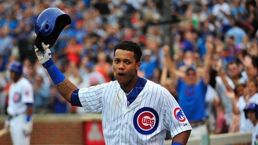 CHICAGO, IL - SEPTEMBER 18: Starlin Castro #13 of the Chicago Cubs tips his helmet to the fans after hitting three-run home run against the St. Louis Cardinals during the sixth inning on September 18, 2015 at Wrigley Field in Chicago, Illinois. (Photo by David Banks/Getty Images)
