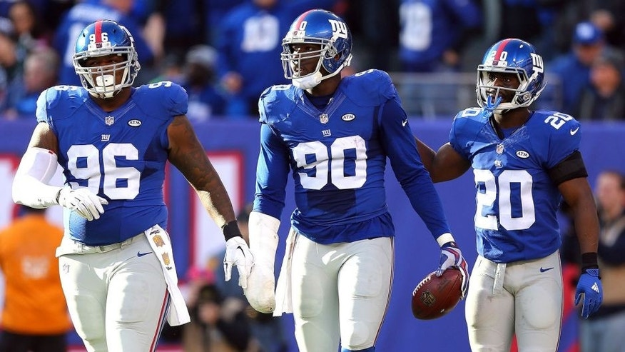 EAST RUTHERFORD, NJ - DECEMBER 06: Jason Pierre-Paul #90 of the New York Giants celebrates after recovering a fumble in the second quarter with Prince Amukamara #20 and Jay Bromley #96 against the New York Jets at MetLife Stadium on December 6, 2015 in East Rutherford, New Jersey. (Photo by Elsa/Getty Images)