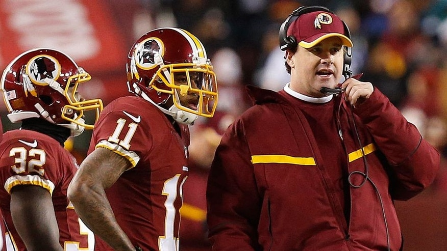 Dec 20, 2014; Landover, MD, USA; Washington Redskins head coach Jay Gruden (R) talks to Redskins wide receiver DeSean Jackson (11) on the sidelines against the Philadelphia Eagles in the fourth quarter at FedEx Field. The Redskins won 27-24. Mandatory Credit: Geoff Burke-USA TODAY Sports