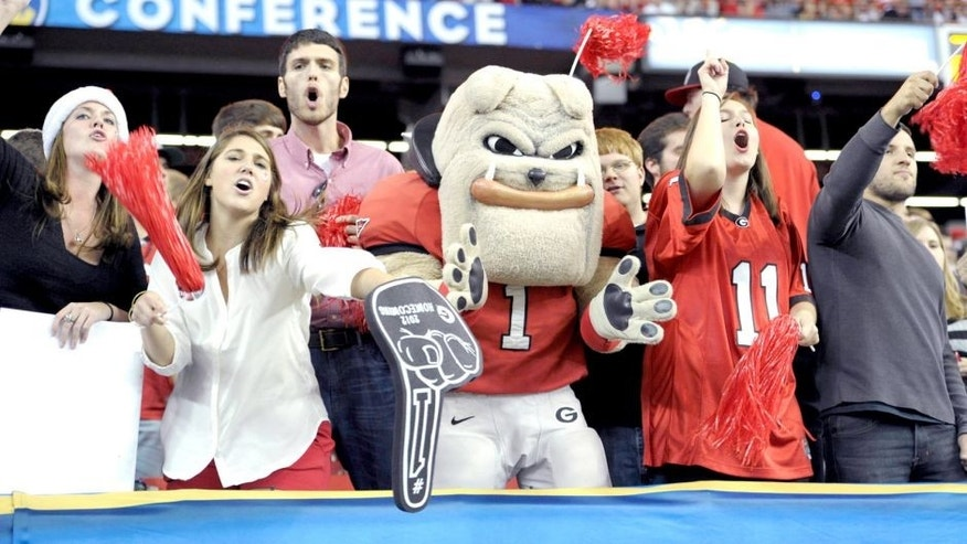 Dec 1, 2012; Atlanta, GA, USA; The Georgia Bulldogs mascot cheers with fans during the third quarter of the 2012 SEC Championship game against the Alabama Crimson Tide at the Georgia Dome. Mandatory Credit: Paul Abell-USA TODAY Sports