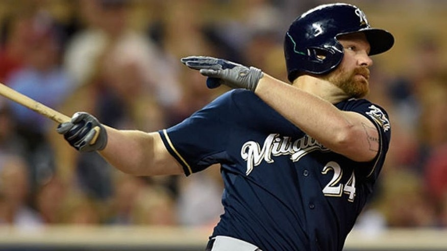 MINNEAPOLIS, MN - JUNE 5: Adam Lind #24 of the Milwaukee Brewers hits an RBI double against the Minnesota Twins during the eighth inning of the game on June 5, 2015 at Target Field in Minneapolis, Minnesota. The Brewers defeated the Twins 10-5. (Photo by Hannah Foslien/Getty Images)