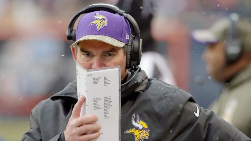 Minnesota Vikings head coach Mike Zimmer watches his team during the first half of an NFL football game against the Chicago Bears Sunday, Nov. 16, 2014 in Chicago. (AP Photo/Charles Rex Arbogast)