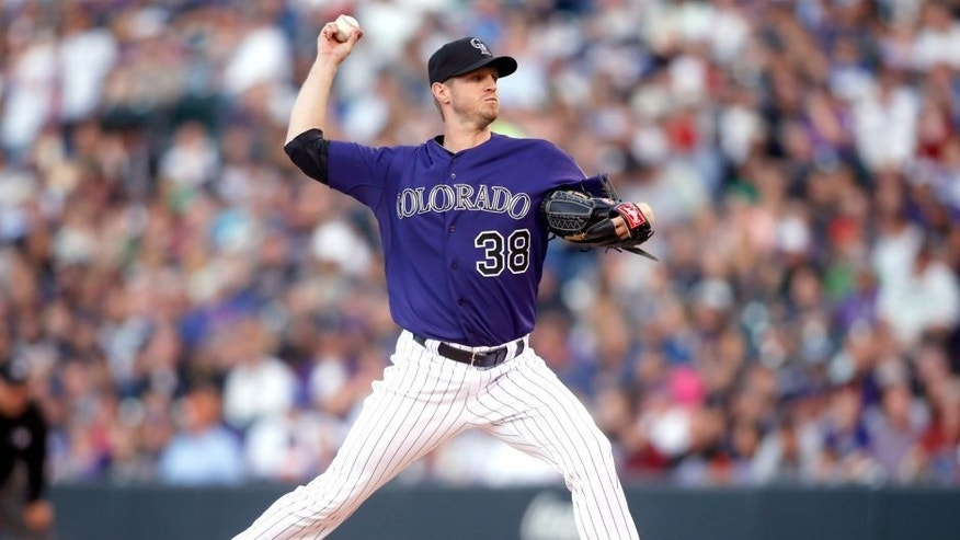Apr 11, 2015; Denver, CO, USA; Colorado Rockies starting pitcher Kyle Kendrick (38) pitches the ball during the second inning against the Chicago Cubs at Coors Field. Mandatory Credit: Chris Humphreys-USA TODAY Sports