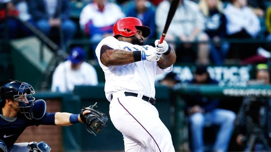 Apr 28, 2015; Arlington, TX, USA; Texas Rangers designated hitter Prince Fielder (84) follows through on his single against the Seattle Mariners during the first inning of a baseball game at Globe Life Park in Arlington. Mandatory Credit: Jim Cowsert-USA TODAY Sports
