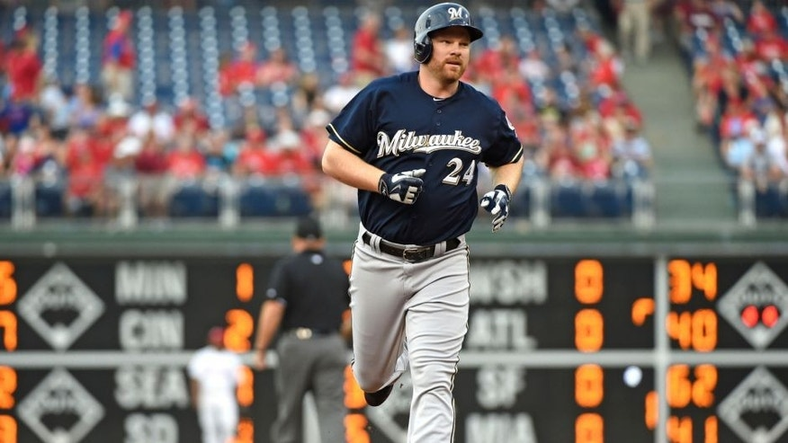 <p>Jul 1, 2015; Philadelphia, PA, USA; Milwaukee Brewers first baseman Adam Lind (24) runs the bases after hitting a two run home run in the first inning against the Philadelphia Phillies at Citizens Bank Park. Mandatory Credit: Eric Hartline-USA TODAY Sports</p>