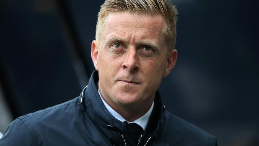 FILE - This is a Saturday, April 25, 2015 file photo of Swansea City's manager Garry Monk as he awaits for the start of their English Premier League soccer match between Newcastle United and Swansea City at St James' Park, Newcastle, England. Swansea  fired manager Garry Monk Wednesday Dec. 9, 2015, after nearly two years in charge, following a dip in form that has seen the team win just one of its last 11 Premier League games. (AP Photo/Scott Heppell, File)