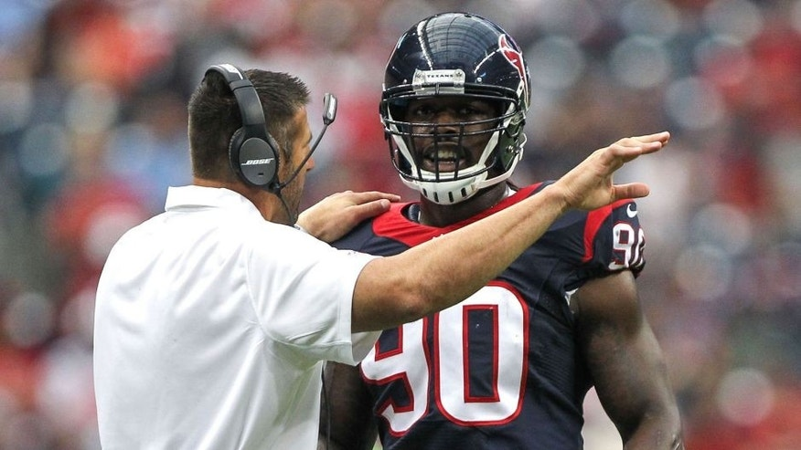 Aug 16, 2014; Houston, TX, USA; Houston Texans linebackers coach Mike Vrabel talks with linebacker Jadeveon Clowney (90) during the first quarter against the Atlanta Falcons at NRG Stadium. Mandatory Credit: Troy Taormina-USA TODAY Sports