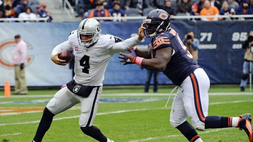 Oct 4, 2015; Chicago, IL, USA; Oakland Raiders quarterback Derek Carr (4) is sacked by Chicago Bears nose tackle Eddie Goldman (91) in the first half at Soldier Field. Mandatory Credit: Matt Marton-USA TODAY Sports