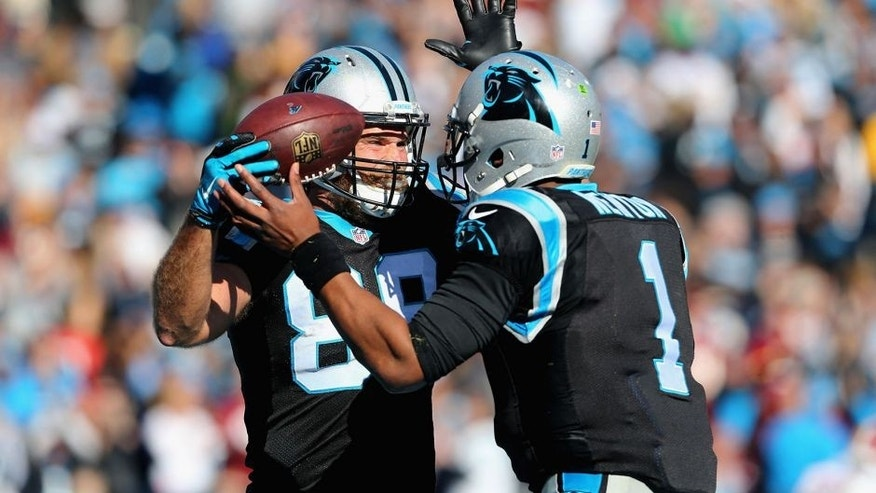 CHARLOTTE, NC - NOVEMBER 22: Greg Olsen #88 and teammate Cam Newton #1 of the Carolina Panthers celebrate a touchdown against the Washington Redskins in the 2nd quarter during their game at Bank of America Stadium on November 22, 2015 in Charlotte, North Carolina. (Photo by Streeter Lecka/Getty Images)