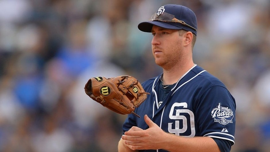 Oct 4, 2015; Los Angeles, CA, USA; San Diego Padres second baseman Jedd Gyorko (9) tosses his glove in between pitches during the seventh inning of the game against the Los Angeles Dodgers at Dodger Stadium. The Dodgers won 6-3. Mandatory Credit: Jayne Kamin-Oncea-USA TODAY Sports