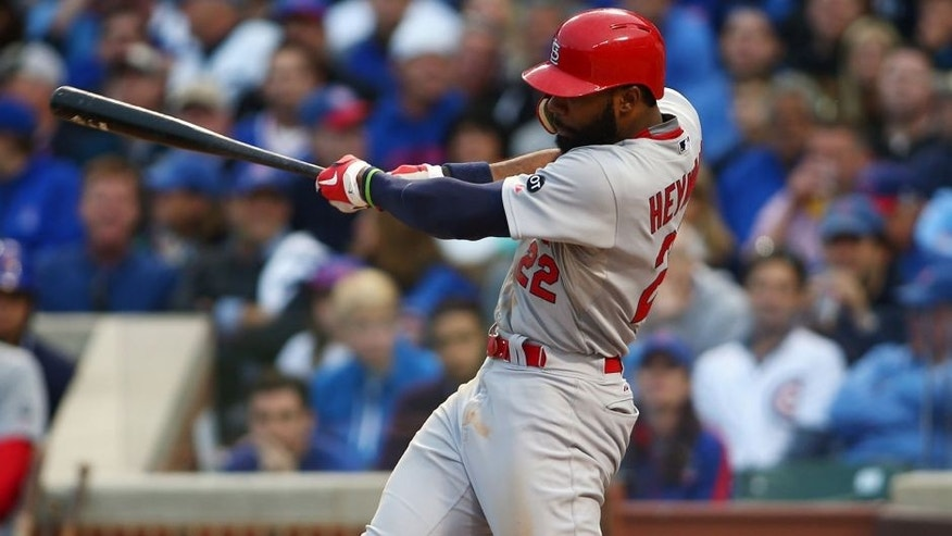 October 13, 2015; Chicago, IL, USA; St. Louis Cardinals right fielder Jason Heyward (22) hits a single in the sixth inning against Chicago Cubs in game four of the NLDS at Wrigley Field. Mandatory Credit: Jerry Lai-USA TODAY Sports