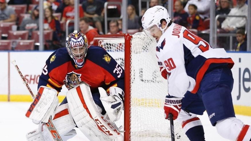 Washington Capitals center Marcus Johansson (90) attempts a shot against Florida Panthers goalie Al Montoya (35) during the first period of an NHL hockey game, Thursday, Dec. 10, 2015 in Sunrise, Fla. (AP Photo/Wilfredo Lee)