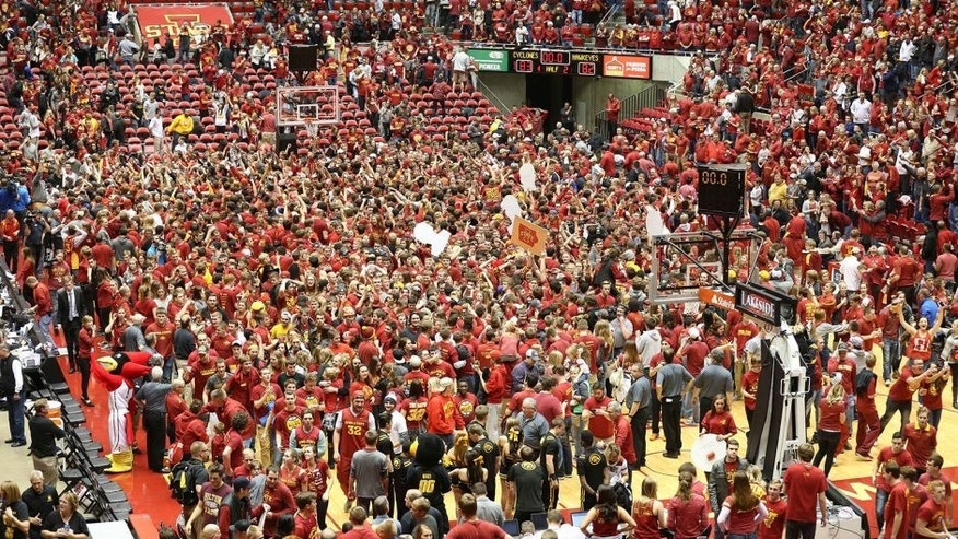Dec 10, 2015; Ames, IA, USA; Iowa State Cyclones students rush the court after beating the Iowa Hawkeyes at James H. Hilton Coliseum. The Cyclones beat the Hawkeyes 83-82. Mandatory Credit: Reese Strickland-USA TODAY Sports