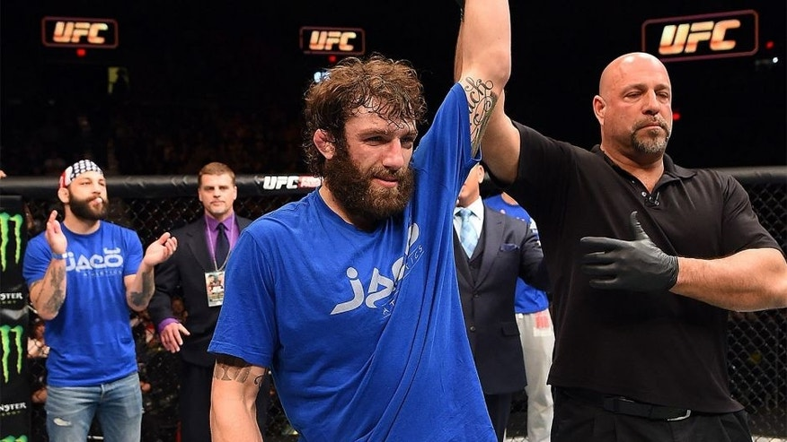 FAIRFAX, VA - APRIL 04: Michael Chiesa celebrates after defeating Mitch Clarke in their lightweight fight during the UFC Fight Night event at the Patriot Center on April 4, 2015 in Fairfax, Virginia. (Photo by Josh Hedges/Zuffa LLC/Zuffa LLC via Getty Images)