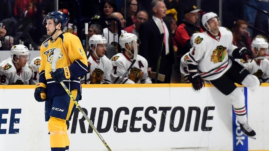 Nashville Predators left wing Filip Forsberg (9), of Sweden, skates back to the bench after scoring a goal in the first period of an NHL hockey game against the Chicago Blackhawks, Thursday, Dec. 10, 2015, in Nashville, Tenn. (AP Photo/Mark Zaleski)