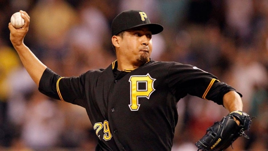 Jul 22, 2014; Pittsburgh, PA, USA; Pittsburgh Pirates relief pitcher Ernesto Frieri (29) pitches against the Los Angeles Dodgers during the ninth inning at PNC Park. The Pirates won 12-7. Mandatory Credit: Charles LeClaire-USA TODAY Sports