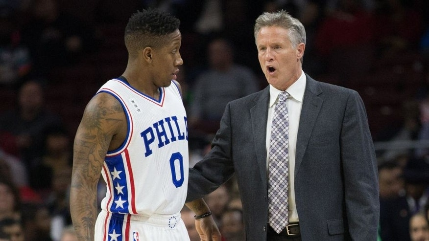 Dec 7, 2015; Philadelphia, PA, USA; Philadelphia 76ers head coach Brett Brown talks with guard Isaiah Canaan (0) during a timeout against the San Antonio Spurs at Wells Fargo Center. The Spurs won 119-68. Mandatory Credit: Bill Streicher-USA TODAY Sports